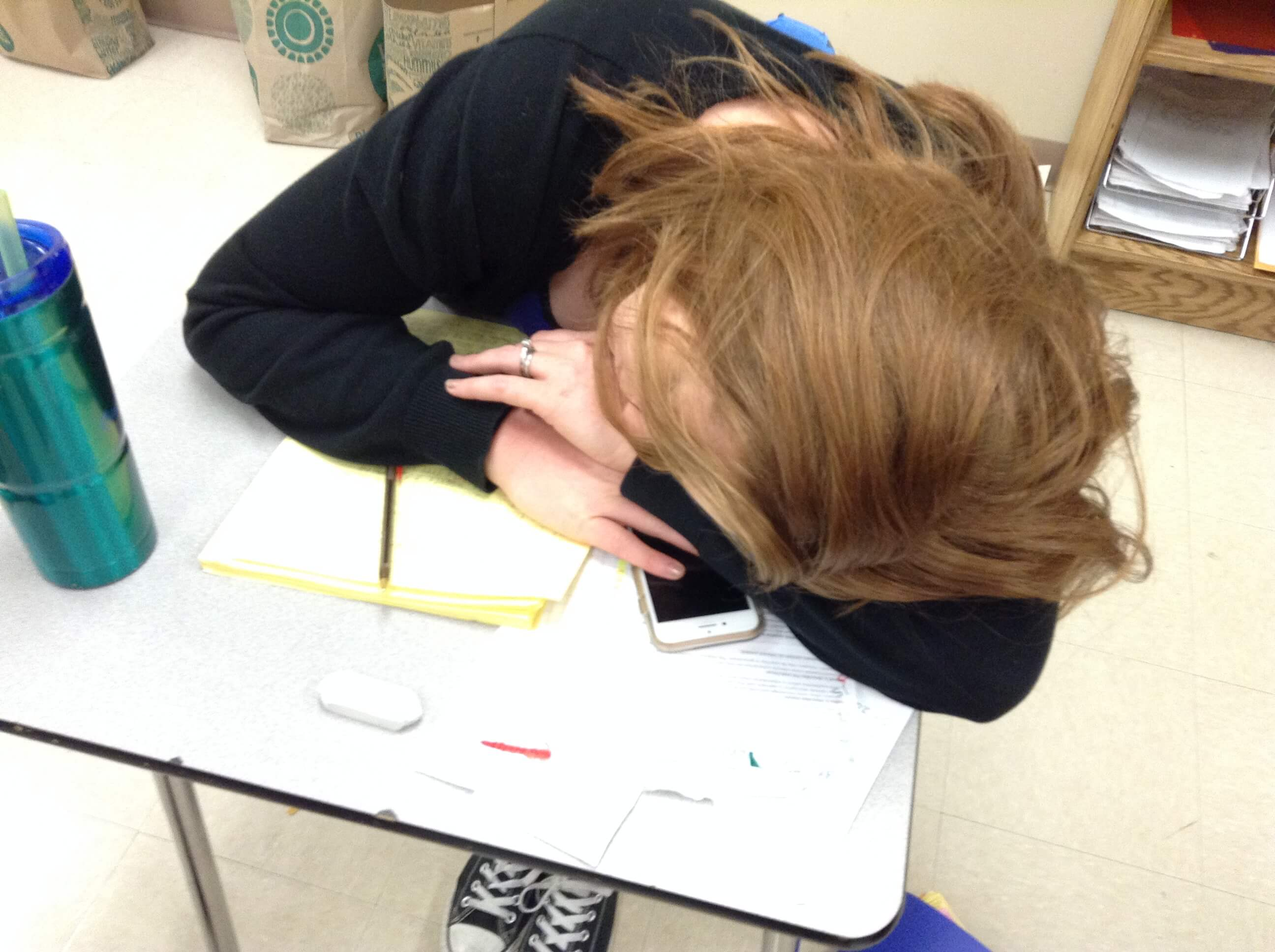 Mrs. Gennaro rests her head after a long day teaching Geometry