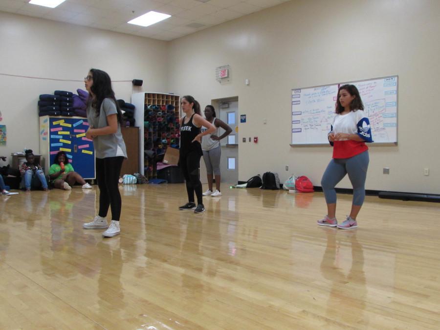 Junior choreographer, Tatiana Iskandarian goes over the choreography with the first select group.