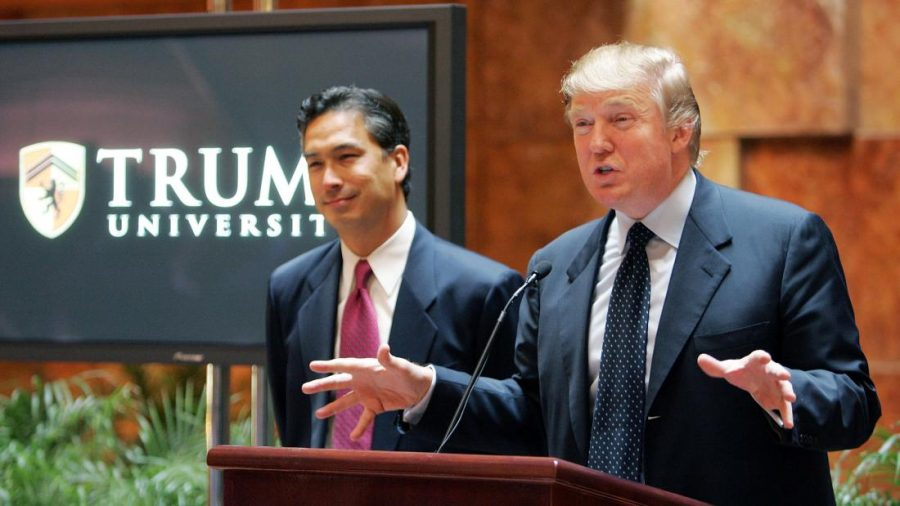 NEW YORK - MAY 23:  Real estate mogul Donald Trump (R) speaks as university president Michael Sexton (L) looks on during a news conference announcing the establishment of Trump University May 23, 2005 in New York City. Trump University will consist of on-line courses, CD-ROMS and other learning programs for business professionals.  (Photo by Mario Tama/Getty Images)