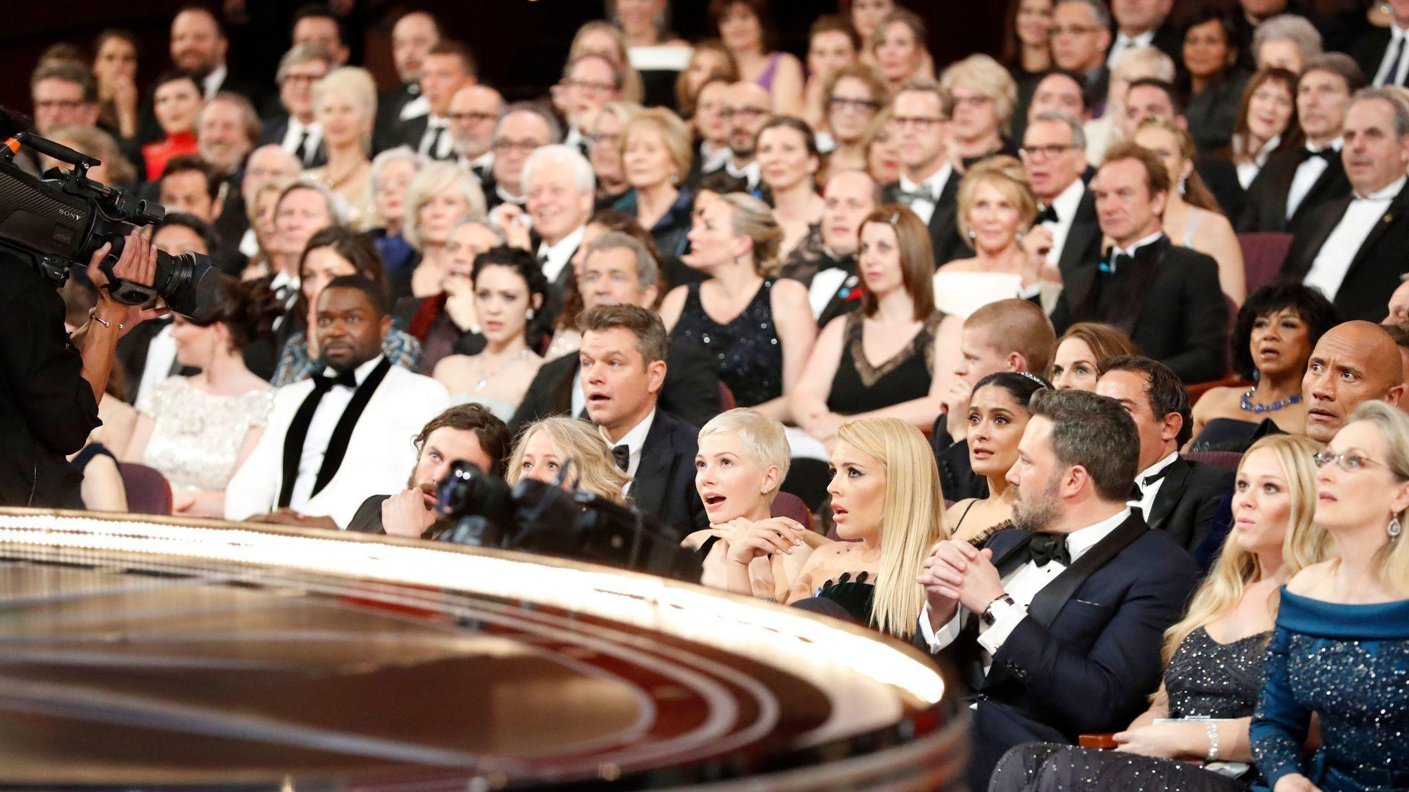 The audience reacts as Moonlight is announced as the real winner.