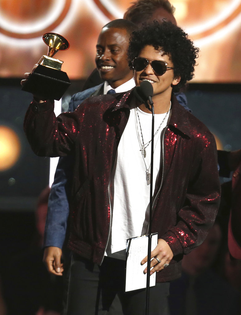 Bruno Mars accepting one of his many Grammy's for